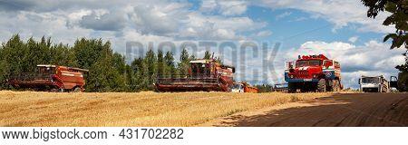 Belarus, Vitebsk Region, July 21, 2021. Combine Harvesters In The Field For Harvesting Wheat. Specia