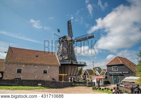 Oudeschild, The Netherlands. August 13 2021. De Molen In Het Dorpje Oudeschild Op Het Eiland Texel.