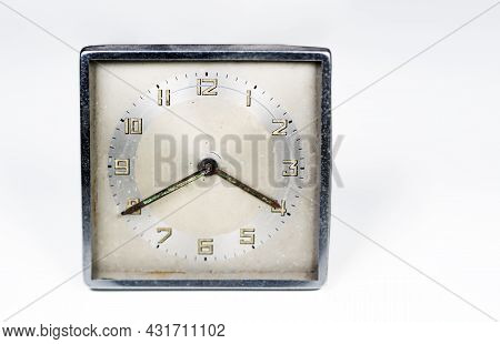 Old Worn Clock With Square Dial Isolated On A White Background. Analog Time Measurement. Vintage And