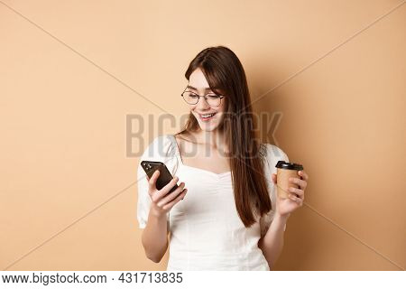 Happy Girl Chatting On Phone And Drinking Coffee, Wearing Eyewear And White Blouse, Smiling At Smart