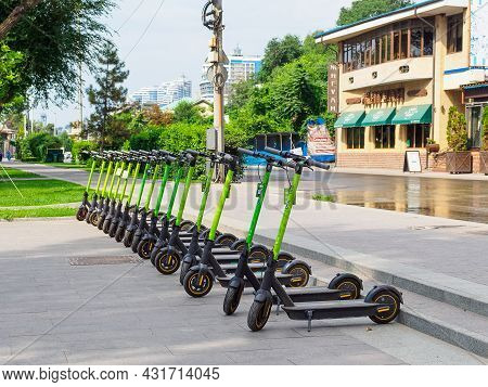Rostov-on-don, Russia - August 29, 2021: Electric Scooters Stand In A Row On The Sidewalk