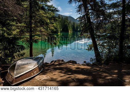Boat On The Lake. The Valley Of The Five Lakes Hike Offers Clear Lakes With Unique Shades Of Jade An
