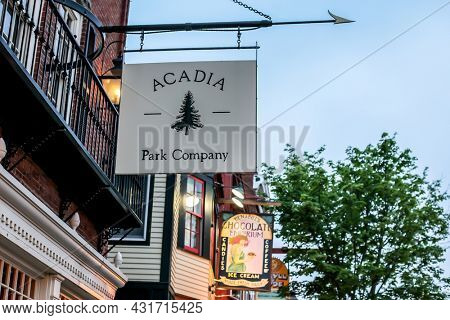 BAR HARBOR, MAINE, USA - JULY 09, 2013: Sign for Acadia Park Company in down town view from street