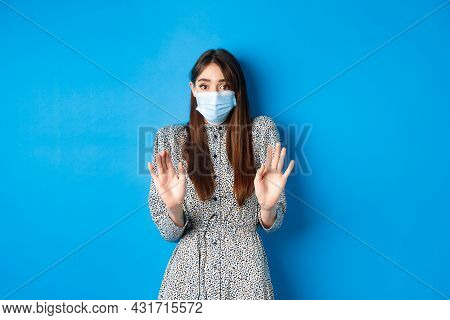 Covid-19, Pandemic Lifestyle Concept. No Thank You. Reluctant And Worried Girl In Medical Mask Askin