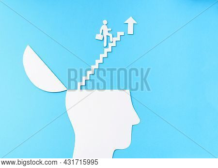 Uplifting And Business Prosper Concept, Paper Cut Open Head With Stairs Up To The Cloud