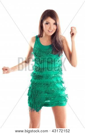 happy dancing woman in green dress over white background