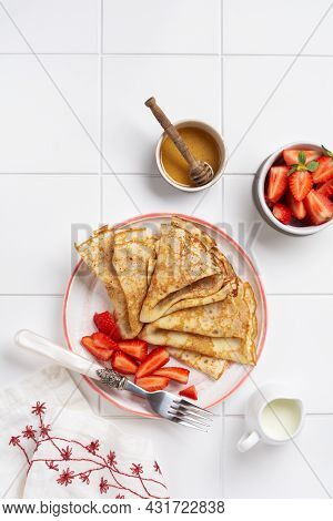 Traditional Dish For Holiday Maslenitsa. Thin Crepes Pancakes With Honey, Fresh Strawberry And Ingre