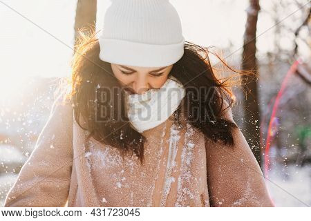 Optimistic Young Woman With Warm Hat On Eyes Smiling While Having Fun On Street On Sunny Winter Day