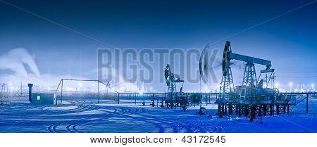 Winter Night Panoramic Oil Pumpjack.