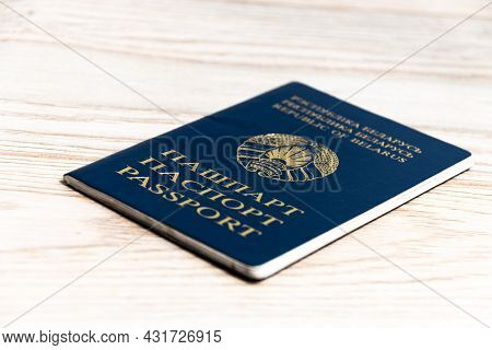 Passport Of A Citizen Of The Republic Of Belarus On A Wooden Background.