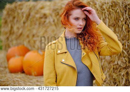 autumn woman on leafs. Park scene