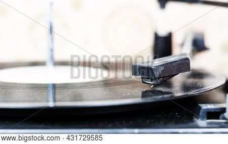 The Needle Of A Turntable Playing The Tracks Of A Black Vinyl Record. Vintage Audio Equipment. Vinyl