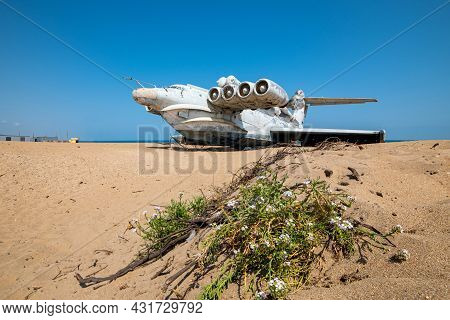 Derbent, Russia-august 30, 2021: Rocket Ship-ekranoplan Lun On The Shore Of The Caspian Sea, A Bush
