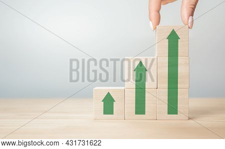 Businesswoman Hand Arranging Wood Cube With Arrow Stacking As Step Stair. Hand Arranging Wood Block
