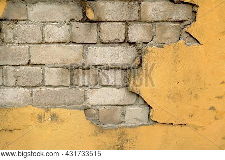 The Empty Background And Texture Is An Old White Brick Street Wall.the Worn Facade Of The Building W