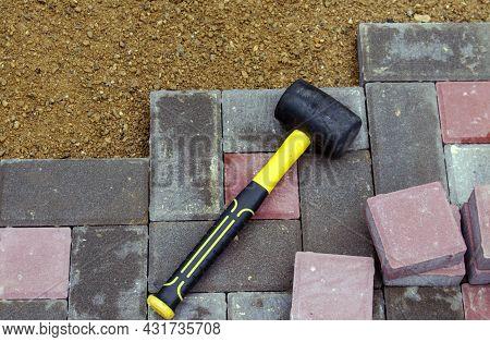 Bricklayer Making Pavement From Stone Blocks. Road Paving, Construction, Sidewalk Repair.