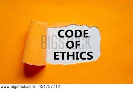 Code Of Ethics Symbol. Words 'code Of Ethics' Appearing Behind Torn Orange Paper. Beautiful Orange B