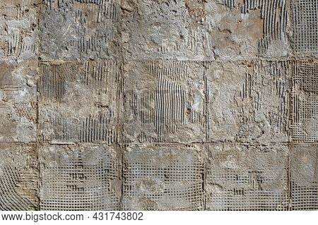 Concrete Wall After Dismantling Of Big Tiles Under Direct Sun Light Full-frame Background And Textur