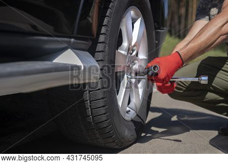 Fixing Wheel Tyre And Disc Of Car With Manual Tool Wrench.