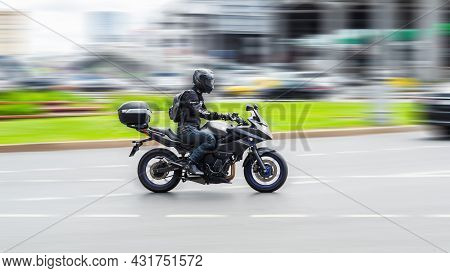 Moscow, Russia - August 2021: Biker Ride Yamaha Motorcycle On The City Road With Motion Blurred Back