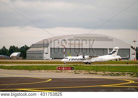 Riga, Latvia - August 31, 2021: Finnair Atr 72-500 (oh-ato) Landing/arrival In Riga/rix/evra Airport