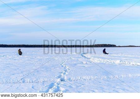 Ice Fishing. Fishermans Fishing On Frozen Lake. Winter Frosty Morning Fishing On River.