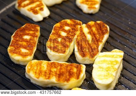 Frying Cheese In A Grill Pan. Halloumi Cheese Has A High Melting Point, And Therefore It Can Be Frie
