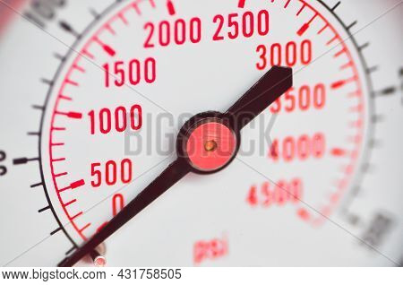 Analog Car Tachometer. The Speed Is Written With Red Numbers