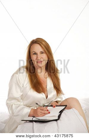 Woman Writing In Journal