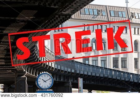 Banner With German Text Streik (meaning Strike) Over An Image With A Clock Under The Curve Of A Subu