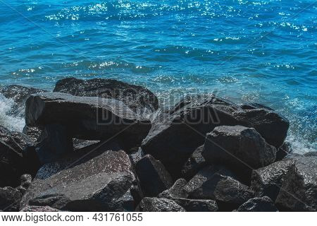 Breakwater Beach Stones On The Sea Coast Against The Background Of The Blue Water.
