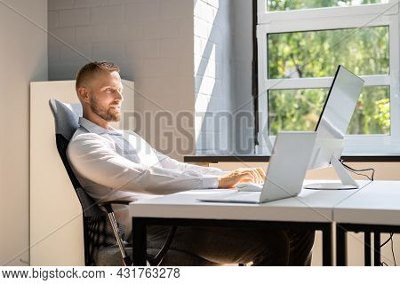 Sitting In Wrong Bad Posture At Office Desk