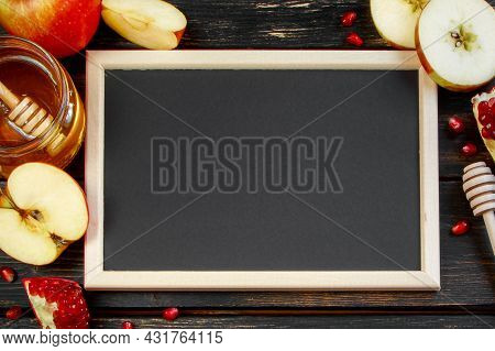 Rosh Hashanah Celebration. Honey, Apples And Pomegranates On A Dark Wooden Background. Frame For Con
