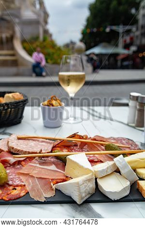 Lunch With Glass Of Brut Champagne Sparkling Wine And Meat And Cheese Board In Street Cafe In Old Ce