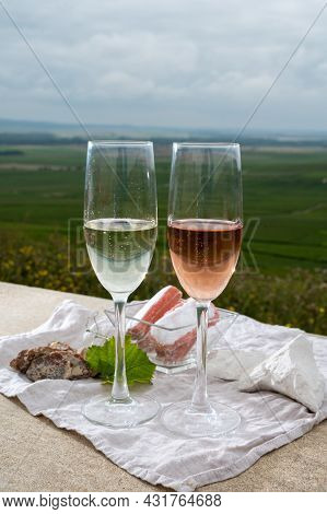 Glasses Of White And Rose Brut Champagne Wine And Examples Of Vineyard Soils, White Chalk Stones And