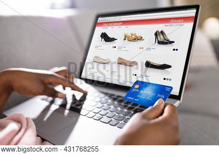 African Person Shopping In Ecommerce Online Shop On Laptop