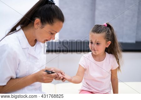 Diabetic Child Blood Sugar Test By Doctor