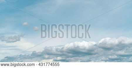 Panorama View Of White Fluffy Clouds On Blue Sky. Close-up White Cumulus Clouds Texture Background.