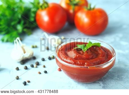 Classic Tomato Sauce With , Pepper And Garlic On A Concrete Background