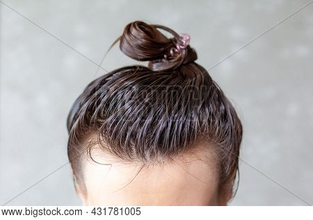Lifestyle Woman Paints Henna Gray Hair, Hair Coloring Self-care. Hair Care At Home. The Woman Applie
