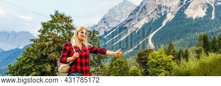 Young Woman And Looking At The Seashore And Mountains At Colorful Sunset In Summer. Landscape With G