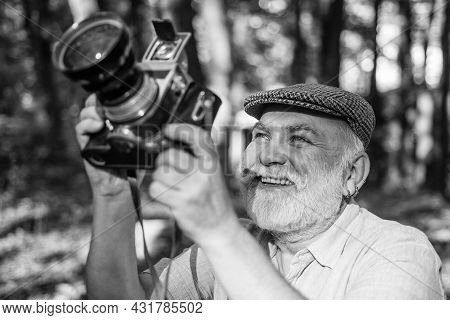 Manual Settings. Pension Hobby. Experienced And Qualified Photographer. Old Man Shoot In Nature. Cam