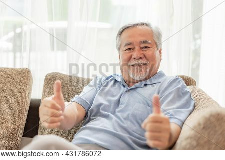 Portrait Asian Senior Man , Old Man Giving A Thumb Up Feel Happy Good Health On Couch Living Room In