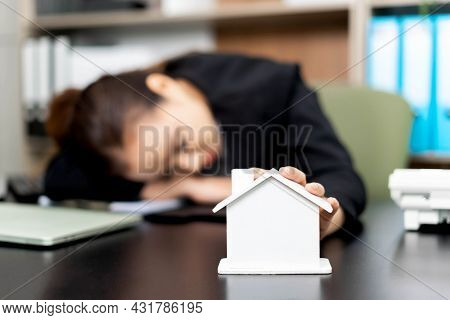 Young Woman Employee Works So Hard That She Falls Asleep On Her Desk Because Her Dream Is To Have A