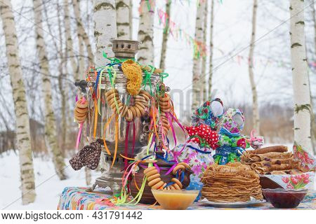 Traditional Russian Maslenitsa Decorations For The Festive Table On Maslenitsa In Russia: Samovar, P