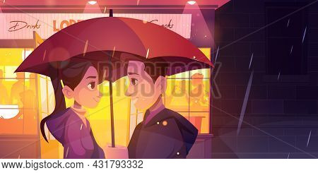 Love Story, Couple Stand Under Umbrella At Rainy Night Street Front Of Glowing Cafe Window. Romantic