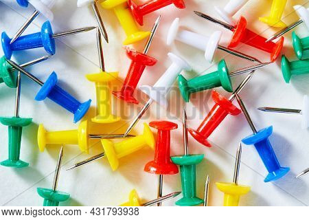 Colored Stationery Buttons Laid Out On Light Background. Carnations For Training. Attaching Paper. O