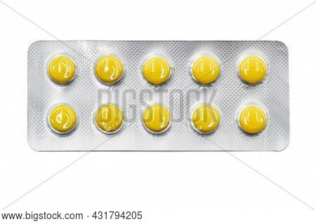 Yellow Pills In Blister Pack Isolated On White Background. Global Pharmaceutical Industry. Closeup,