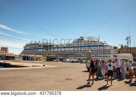 Rhodes, Greece - Jun 03, 2021. View Of The Aida Cruise Ship In Mandraki Harbour Near Old Town And Hi