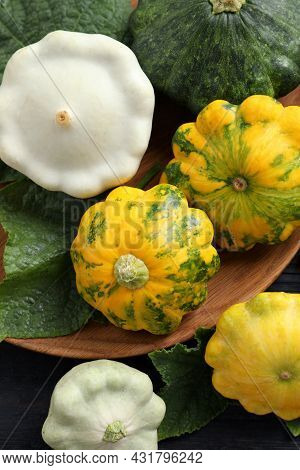 Fresh Ripe Pattypan Squashes With Leaves On Black  Table, Flat Lay